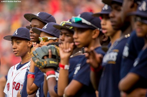 """""""Pitcher Mo'ne Davis of the Anderson Monarchs Little League World Series team looks on before a game between the Boston Red Sox and the Houston Astros at Fenway Park in Boston, Massachusetts Tuesday July 7, 2015."""""""