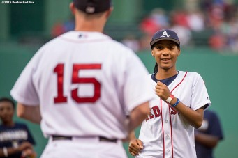 """""""Pitcher Mo'ne Davis of the Anderson Monarchs Little League World Series team reacts after throwing out the ceremonial first pitch to second baseman Dustin Pedroia before a game between the Boston Red Sox and the Houston Astros at Fenway Park in Boston, Massachusetts Tuesday July 7, 2015."""""""