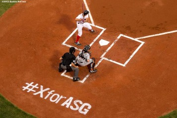 """Boston Red Sox shortstop Xander Bogaerts bats during the first inning of a game against the Miami Marlins at Fenway Park in Boston, Massachusetts Wednesday, July 8, 2015. A stencil is shown in the dirt encouraging fans to vote for Bogaerts to the All-Star Game."""