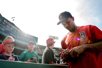 """""""Boston Red Sox shortstop Xander Bogaerts signs autographs before a game against the Miami Marlins at Fenway Park in Boston, Massachusetts Wednesday, July 8, 2015."""""""