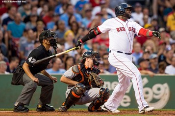 """""""Boston Red Sox first baseman David Ortiz hits a two-run home run during the third inning of a game against the Miami Marlins at Fenway Park in Boston, Massachusetts Wednesday, July 8, 2015."""""""