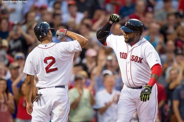 """""""Boston Red Sox first baseman David Ortiz reacts with shortstop Xander Bogaerts after hitting a two-run home run during the third inning of a game against the Miami Marlins at Fenway Park in Boston, Massachusetts Wednesday, July 8, 2015."""""""