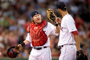 """Boston Red Sox catcher Ryan Hanigan high fives pitcher Rick Porcello after the fourth inning of a game against the Miami Marlins at Fenway Park in Boston, Massachusetts Wednesday, July 8, 2015."""