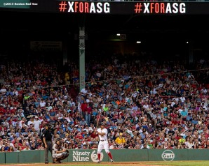 """""""Boston Red Sox shortstop Xander Bogaerts bats during the third inning of a game against the Miami Marlins at Fenway Park in Boston, Massachusetts Wednesday, July 8, 2015."""""""
