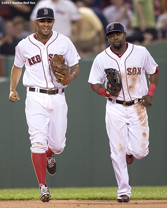 """""""Boston Red Sox shortstop Xander Bogaerts and left fielder Alejandro De Aza laugh during the eighth inning of a game against the Miami Marlins at Fenway Park in Boston, Massachusetts Wednesday, July 8, 2015."""""""