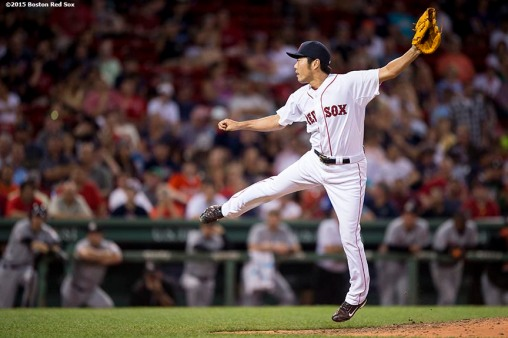 """""""Boston Red Sox pitcher Koji Uehara delivers during the ninth inning of a game against the Miami Marlins at Fenway Park in Boston, Massachusetts Wednesday, July 8, 2015."""""""
