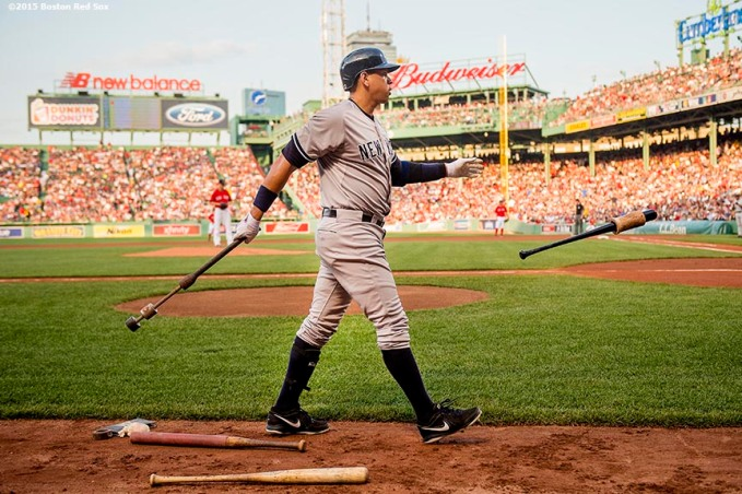 """""""New York Yankees third baseman Alex Rodriguez warms up during the first inning of a game against the Boston Red Sox at Fenway Park in Boston, Massachusetts Friday, July 10, 2015."""""""