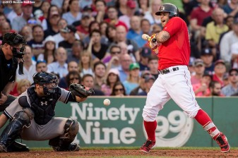 """Boston Red Sox first baseman Mike Napoli is hit by a pitch during the second inning of a game against the New York Yankees at Fenway Park in Boston, Massachusetts Friday, July 10, 2015."""