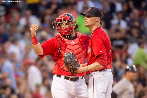 """""""Boston Red Sox pitcher Clay Buchholz and catcher Sandy Leon signal to exit the game during the fourth inning of a game against the New York Yankees at Fenway Park in Boston, Massachusetts Friday, July 10, 2015."""""""