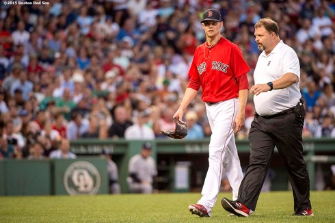 """""""Boston Red Sox pitcher Clay Buchholz exits the game during the fourth inning of a game against the New York Yankees at Fenway Park in Boston, Massachusetts Friday, July 10, 2015."""""""