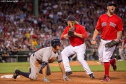 """Boston Red Sox pitcher Robbie Ross Jr. runs to tag out outfielder Brett Gardner during the fourth inning of a game against the New York Yankees at Fenway Park in Boston, Massachusetts Friday, July 10, 2015."""