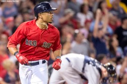 """Boston Red Sox center fielder Mookie Betts looks on as he hits a solo home run during the fifth inning of a game against the New York Yankees at Fenway Park in Boston, Massachusetts Friday, July 10, 2015."""