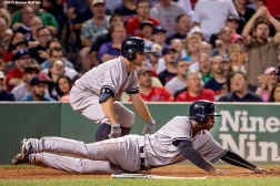 """""""New York Yankees shortstop Didi Gregorius slides as he scores during the eighth inning of a game against the Boston Red Sox at Fenway Park in Boston, Massachusetts Friday, July 10, 2015."""""""