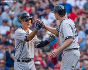 """""""New York Yankees second baseman Rob Refsnyder reacts after hitting a two-run home run during the ninth inning of a game against the Boston Red Sox at Fenway Park in Boston, Massachusetts Sunday, Jul/y 12, 2015. It was his first career Major League home run."""""""