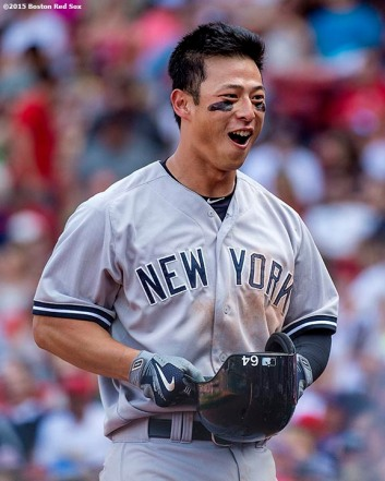 """New York Yankees second baseman Rob Refsnyder reacts after hitting a two-run home run during the ninth inning of a game against the Boston Red Sox at Fenway Park in Boston, Massachusetts Sunday, Jul/y 12, 2015. It was his first career Major League home run."""