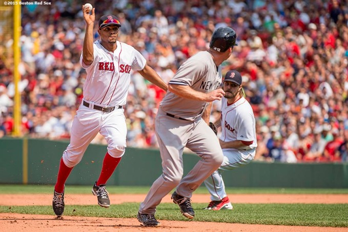 """""""Boston Red Sox shortstop Xander Bogaerts throws during a run-down during a game against the New York Yankees at Fenway Park in Boston, Massachusetts Sunday, July 12, 2015. """""""