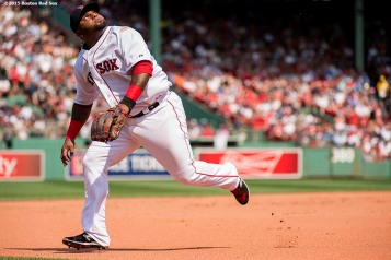 """Boston Red Sox third baseman Pablo Sandoval eyes a pop fly during a game against the New York Yankees at Fenway Park in Boston, Massachusetts Sunday, July 12, 2015. """