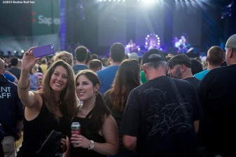 """""""Fans pose for a selfie photograph as the Foo Fighters perform during a concert at Fenway Park in Boston, Massachusetts Saturday, July 18, 2015. """""""