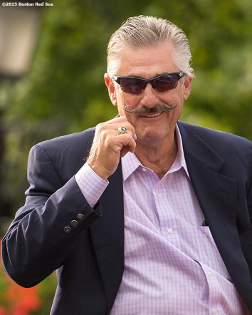 """Hall of Famer Rollie Fingers waves to fans during the Hall of Famers parade during the 2015 Hall of Fame weekend at the National Baseball Hall of Fame in Cooperstown, New York Saturday, July 25, 2015."""