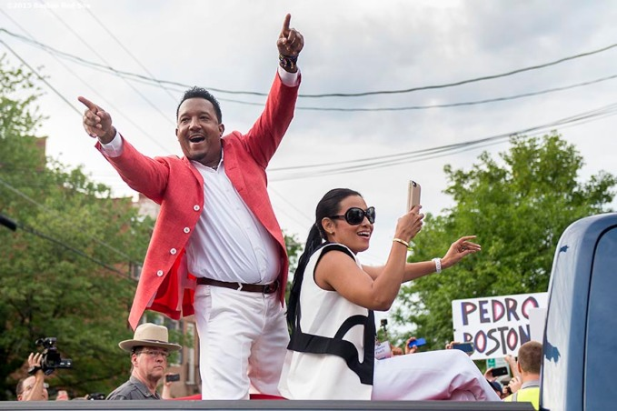 """""""Class of 2015 Hall of Fame inductee Pedro Martinez waves to fans during the Hall of Famers parade during the 2015 Hall of Fame weekend at the National Baseball Hall of Fame in Cooperstown, New York Saturday, July 25, 2015."""""""
