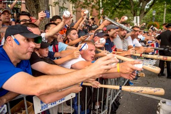 """Fans ask for autographs during the Hall of Famers parade during the 2015 Hall of Fame weekend at the National Baseball Hall of Fame in Cooperstown, New York Saturday, July 25, 2015."""