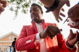 """Class of 2015 Hall of Fame inductee Pedro Martinez signs autographs during the Hall of Famers parade during the 2015 Hall of Fame weekend at the National Baseball Hall of Fame in Cooperstown, New York Saturday, July 25, 2015."""