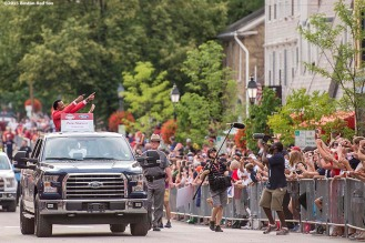"""Class of 2015 Hall of Fame inductee Pedro Martinez waves to fans during the Hall of Famers parade during the 2015 Hall of Fame weekend at the National Baseball Hall of Fame in Cooperstown, New York Saturday, July 25, 2015."""
