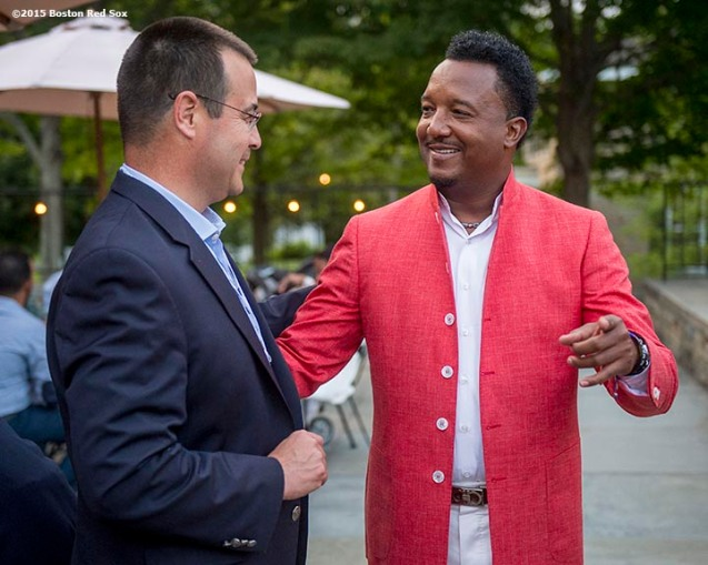 """""""Class of 2015 inductee Pedro Martinez talks with former Boston Red Sox General Manager Dan Duquette at a party at the Fenimore Art Museum during the 2015 Hall of Fame weekend at the National Baseball Hall of Fame in Cooperstown, New York Saturday, July 25, 2015."""""""