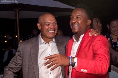 """Class of 2015 inductee Pedro Martinez talks with Hall of Famer Reggie Jackson at a party at the Fenimore Art Museum during the 2015 Hall of Fame weekend at the National Baseball Hall of Fame in Cooperstown, New York Saturday, July 25, 2015."""