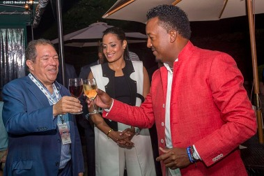 """Class of 2015 inductee Pedro Martinez makes a toast with Executive Vice President & Senior Advisor to the President/CEO Dr. Charles Steinberg at a party at the Fenimore Art Museum during the 2015 Hall of Fame weekend at the National Baseball Hall of Fame in Cooperstown, New York Saturday, July 25, 2015."""