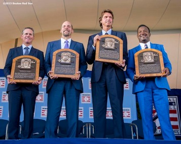 """Hall of Fame class of 2015 inductees Craig Biggio, John Smoltz, Randy Johnson, and Pedro Martinez pose for a photograph with the plaques following the award ceremony during the Hall of Fame weekend at the National Baseball Hall of Fame in Cooperstown, New York Sunday, July 26, 2015."""