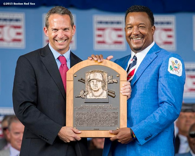 """Hall of Fame class of 2015 inductee Pedro Martinez poses for a photograph with Hall of Fame President Jeff Idelson and the plaque during the awards presentation during the 2015 Hall of Fame weekend at the National Baseball Hall of Fame in Cooperstown, New York Sunday, July 26, 2015."""