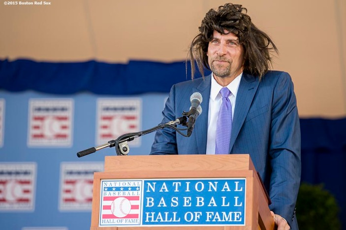 """""""Class of 2015 Hall of Fame inductee John Smoltz wears a wig as he speaks at the plaque ceremony during the 2015 Hall of Fame weekend at the National Baseball Hall of Fame in Cooperstown, New York Sunday, July 26, 2015."""""""