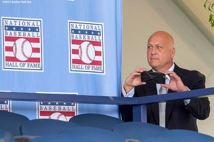 """""""Hall of Famer Cal Ripken Jr. peeks out from backstage to take a photograph at the plaque ceremony during the 2015 Hall of Fame weekend at the National Baseball Hall of Fame in Cooperstown, New York Sunday, July 26, 2015."""""""
