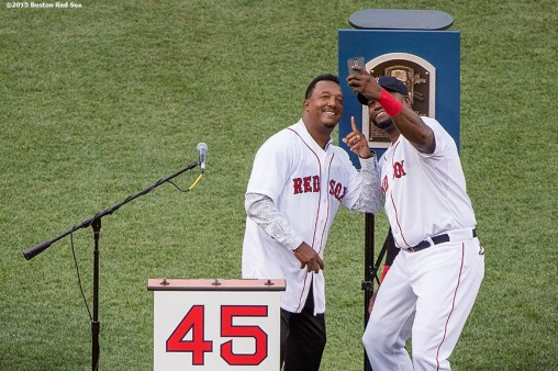 """Hall of Fame inductee Pedro Martinez poses for a selfie photograph with Boston Red Sox designated hitter David Ortiz during a ceremony retiring his number before a game against the Chicago White Sox at Fenway Park in Boston, Massachusetts Tuesday, July 28, 2015."""