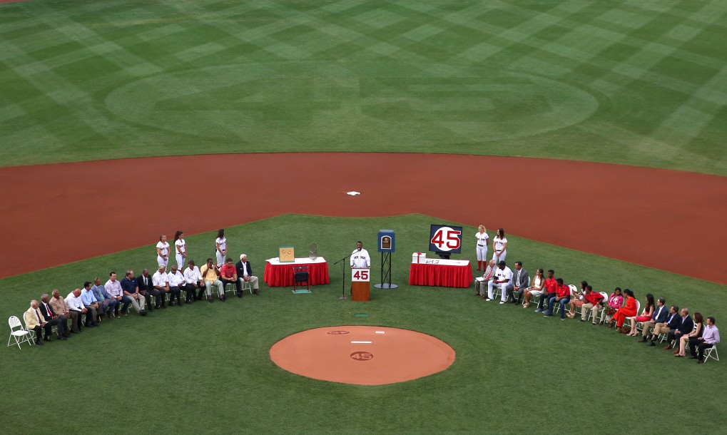 """""""Hall of Fame inductee Pedro Martinez speaks during a ceremony retiring his number before a game against the Chicago White Sox at Fenway Park in Boston, Massachusetts Tuesday, July 28, 2015."""""""