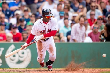 """Boston Red Sox right fielder Rusney Castillo bunts during the fifth inning of a game against the Tampa Bay Rays at Fenway Park in Boston, Massachusetts Saturday, August 1, 2015."""