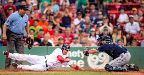 """Boston Red Sox third baseman Travis Shaw slides as he scores during the sixth inning of a game against the Tampa Bay Rays at Fenway Park in Boston, Massachusetts Saturday, August 1, 2015. (Photo by Billie Weiss/Boston Red Sox)"