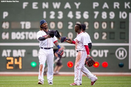 """Boston Red Sox outfielders Hanley Ramirez, Rusney Castillo, and Jackie Bradley Jr. high five after a game against the Tampa Bay Rays at Fenway Park in Boston, Massachusetts Saturday, August 1, 2015."""