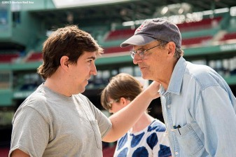 """Singer James Taylor greets Boston Marathon bombing survivor Jeff Bauman before a concert at Fenway Park in Boston, Massachusetts Thursday, August 6, 2015."""