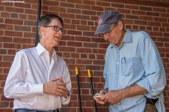 """Boston Red Sox Principal Owner John Henry talks with singer James Taylor before a concert at Fenway Park in Boston, Massachusetts Thursday, August 6, 2015."""