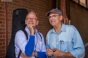 """Singer James Taylor looks on with his brother Livingston Taylor before a concert at Fenway Park in Boston, Massachusetts Thursday, August 6, 2015."""