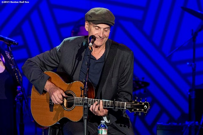 """Singer James Taylor performs during a concert at Fenway Park in Boston, Massachusetts Thursday, August 6, 2015."""