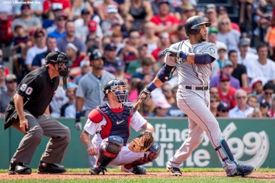 """Seattle Mariners second baseman Robinson Cano hits a double during the sixth inning of a game against the Boston Red Sox at Fenway Park in Boston, Massachusetts Sunday, August 16, 2015."""