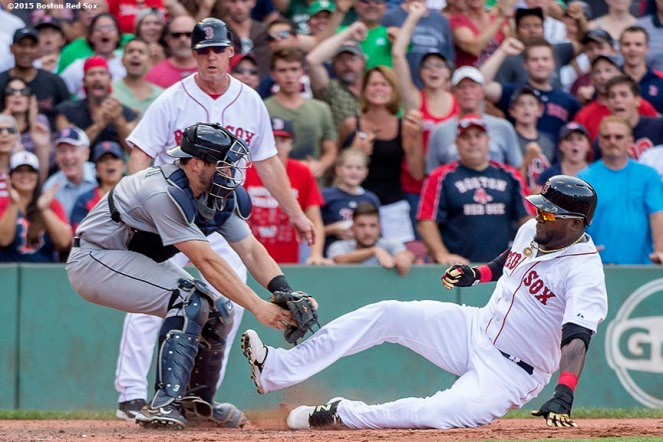 """Boston Red Sox designated hitter David Ortiz is tagged out as he attempts to score during the ninth inning of a game against the Seattle Mariners at Fenway Park in Boston, Massachusetts Sunday, August 16, 2015."""