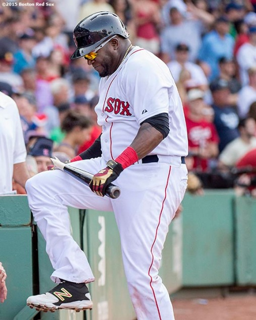 """Boston Red Sox designated hitter David Ortiz breaks his bat over his knee during the tenth inning of a game against the Seattle Mariners at Fenway Park in Boston, Massachusetts Sunday, August 16, 2015."""