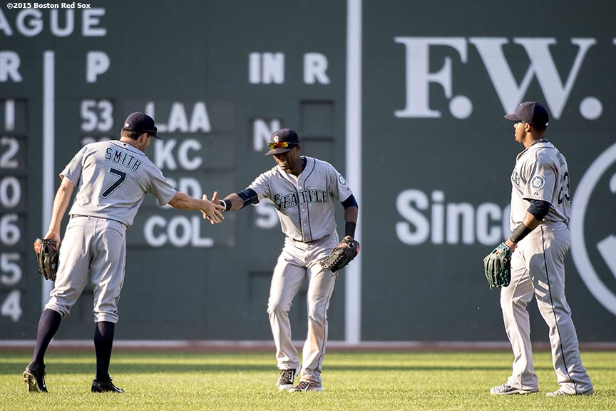 """Seattle Mariners outfielders react after defeating the Boston Red Sox at Fenway Park in Boston, Massachusetts Sunday, August 16, 2015."""