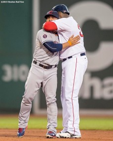 """""""Boston Red Sox designated hitter David Ortiz reacts with Cleveland Indians third baseman Mike Aviles during the second inning of a game against the Cleveland Indians at Fenway Park in Boston, Massachusetts Tuesday, August 18, 2015."""""""
