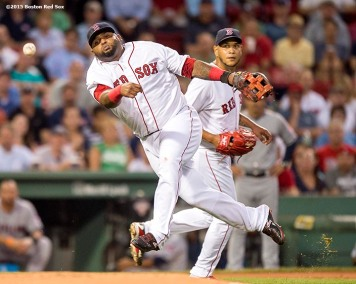"""Boston Red Sox third baseman Pablo Sandoval throws to first base as pitcher Eduardo Rodriguez looks on during the first inning of a game against the Cleveland Indians at Fenway Park in Boston, Massachusetts Tuesday, August 18, 2015."""