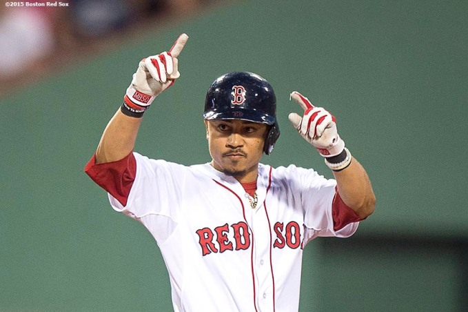 """Boston Red Sox center fielder Mookie Betts reacts after hitting a bases clearing RBI double during the second inning of a game against the Cleveland Indians at Fenway Park in Boston, Massachusetts Tuesday, August 18, 2015."""